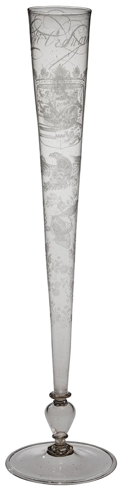 tall and thin conical glass with etched design