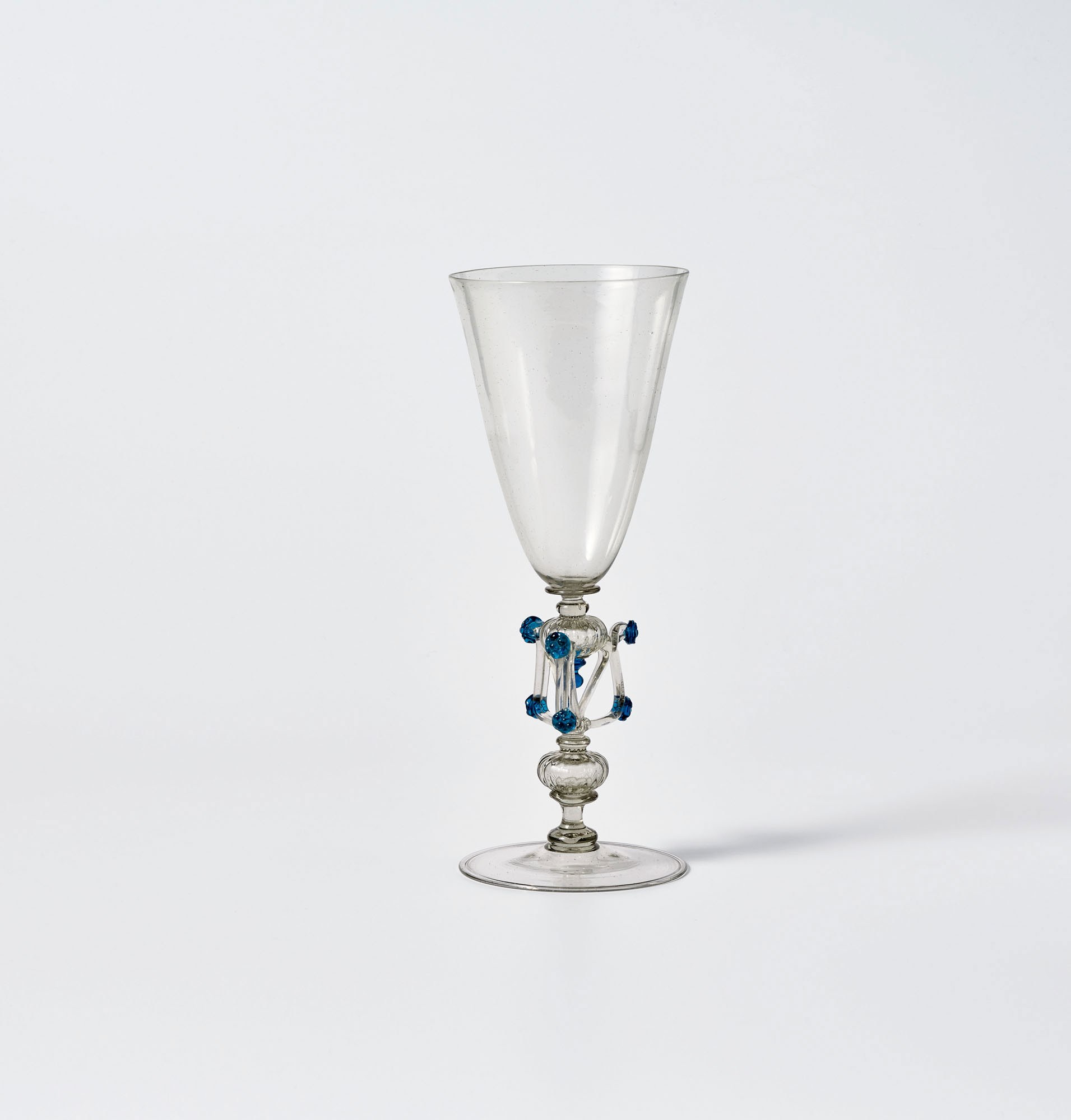 Clear glass goblet with decorative stem featuring a cube shape with blue dots on corners