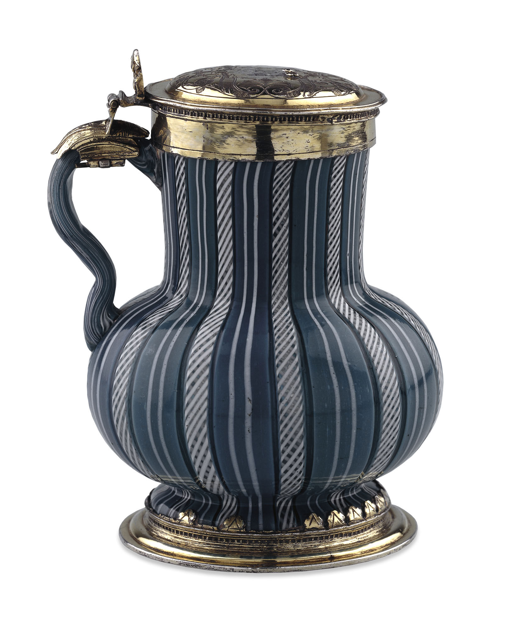 Glass tankard with rounded bottom and long straight neck covered in vertical turquoise stripes with silver lid and base