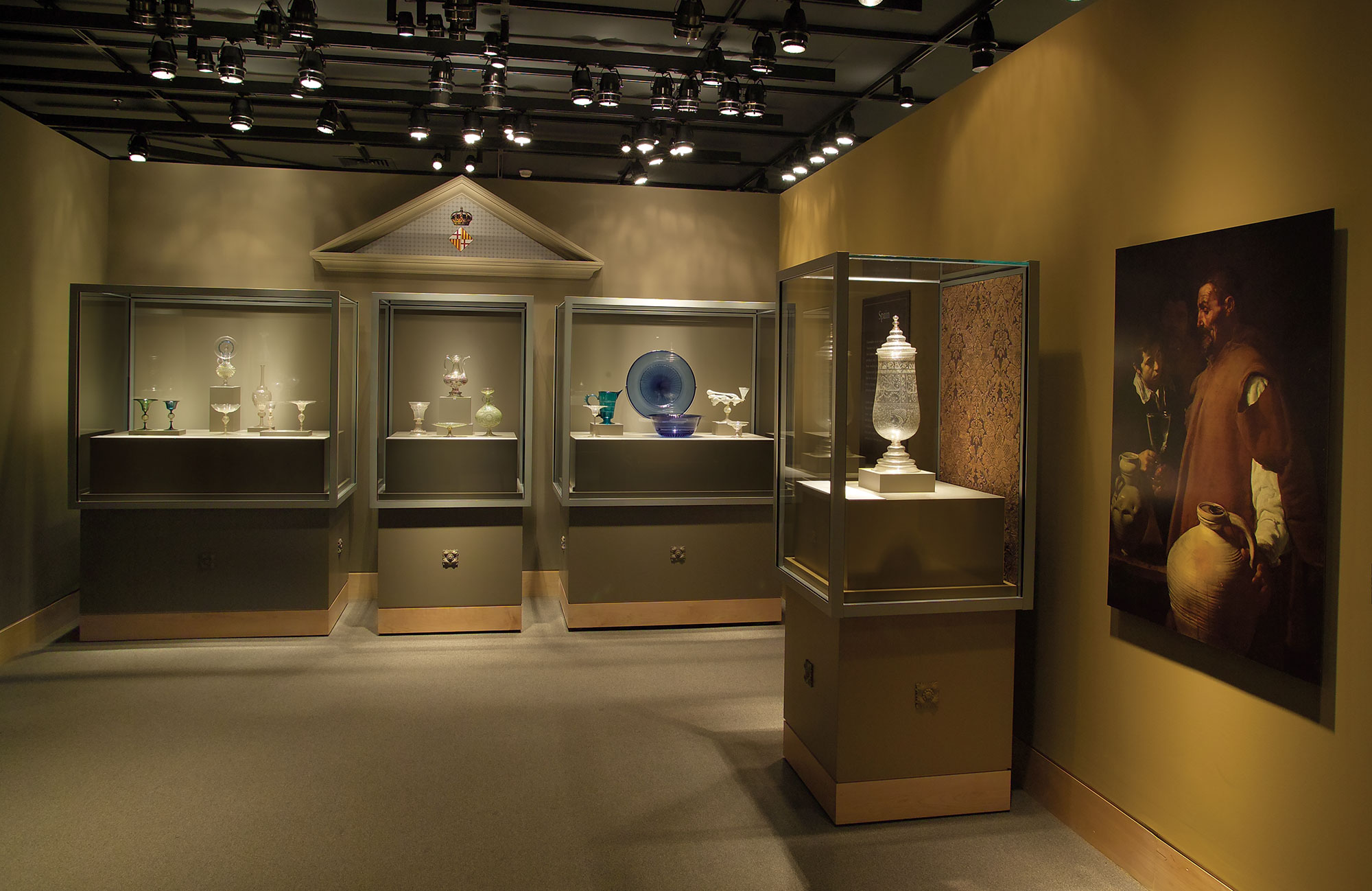 Spain area of Beyond Venice exhibition showing four object cases