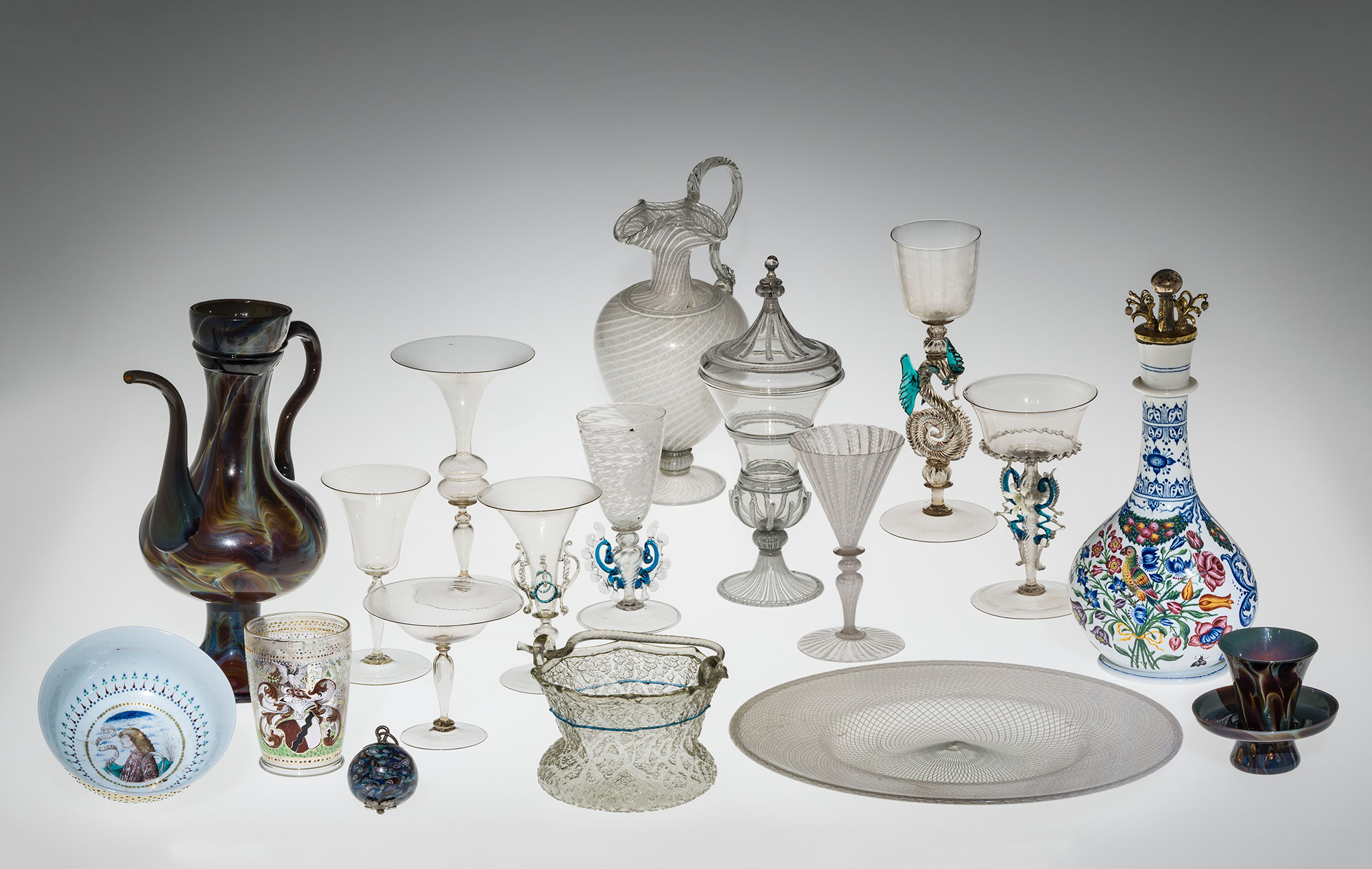 18 Venetian glass objects including goblets, beakers, tankards, and plates
