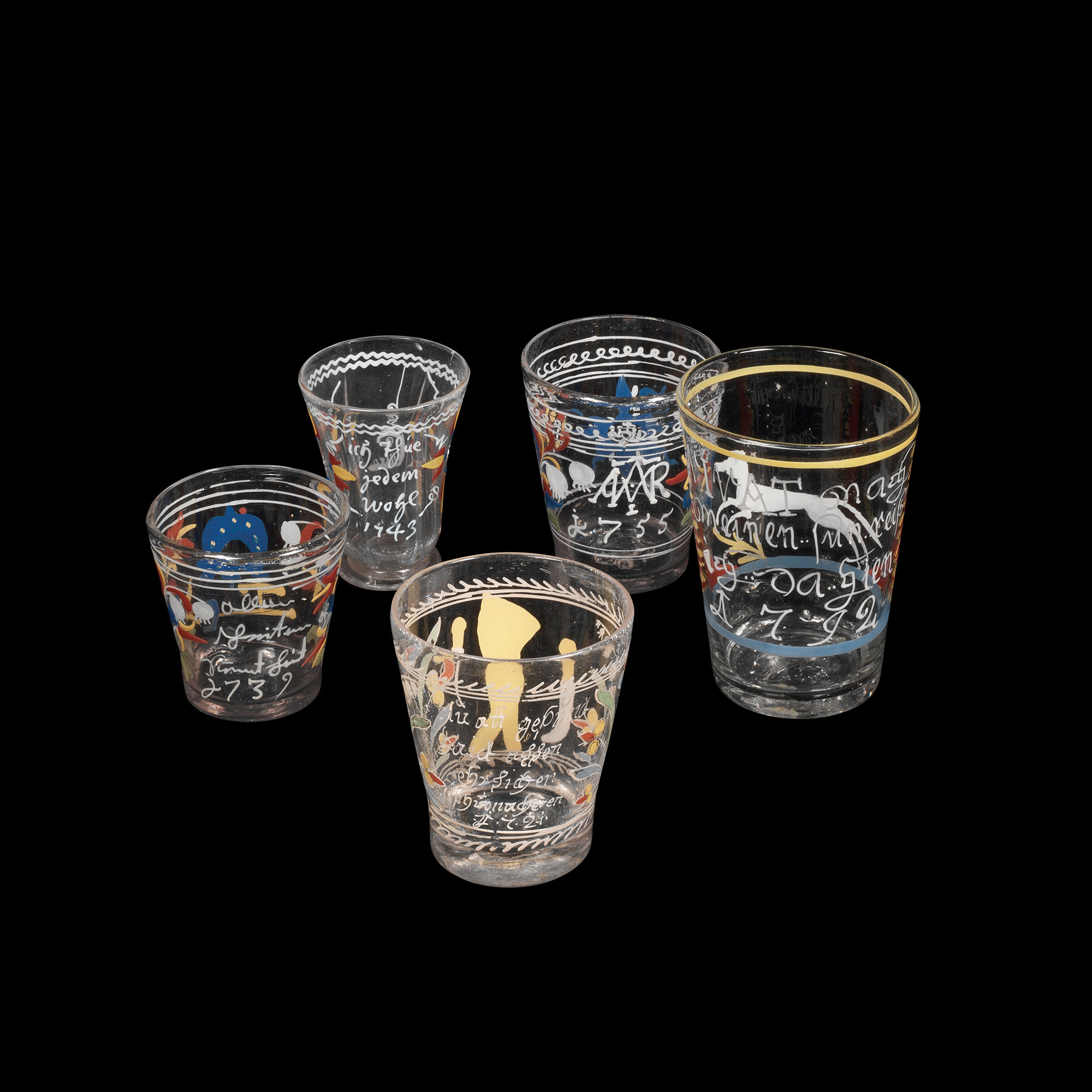 Five clear glasses decorated in enamel