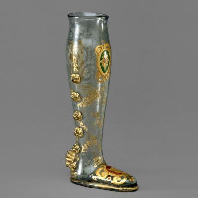 Glass boot-shaped vessel with gold decorations