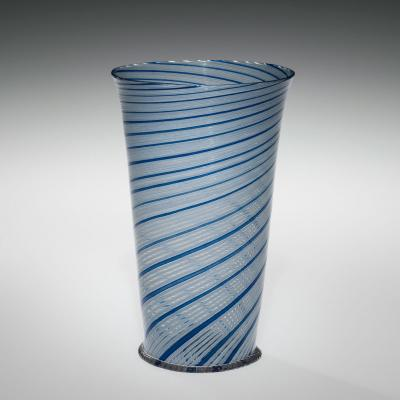 Thin, clear glass with spirals of four opaque white stripes and one light blue that wrap around the vessel