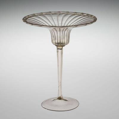 Clear wineglass with white stripes and very shallow, flared bowl