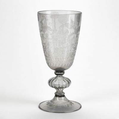 Clear glass goblet engraved with a stag, a unicorn, and hounds, and the owners' initials RT and AT entwined by lover's knots